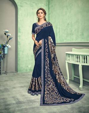 Flower, gold, double sequins and the color of royalty - each element in this saree is absolutely stunning.  Pair it with statement earrings and look like a diva