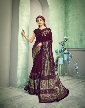 An very artistic piece - this purplish-wine saree with floral and sequins details will give you an unforgettable appearance. Pair it with subtle jewels and look mesmerizing.