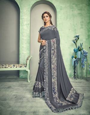 This matte grey saree is trendy and one-of-a-kind . With tasseled sequins and crush-frill details the saree is in itself a piece of utmost style.
