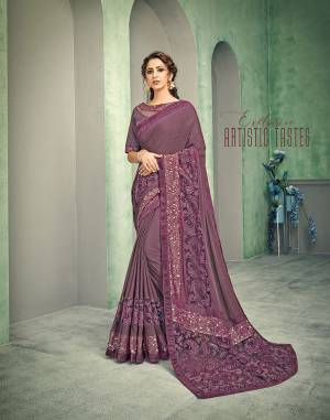 A shade of mauve itself makes the whole saree amazingly modern . Enhanced short pallu, fur sequinned details and unique cuts - each element screams style and trend.