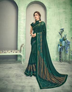 Get ready to look like a glamour queen in this green and gold saree . The amazing diagonal cut of the short pallu and adornment of tasseled sequins is as beautiful as it can get.