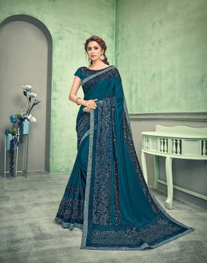 Shine through your next event in this gorgeous teal blue saree with a playful amalgamation of floral sequins and fur sequins and crush details. A perfect pick if you like it bold, beautiful and unique.