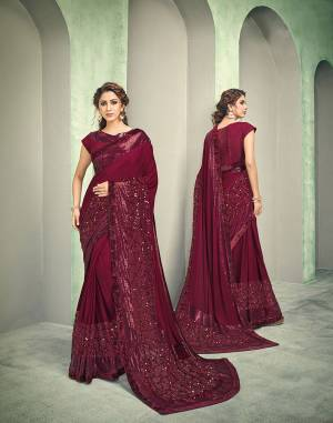 Maroon is the color of feminity. With a perfect shimmery sheen of multiple sequinned-fabrics and subtlety of their placements , this saree will lend you that fashionista look like never before.