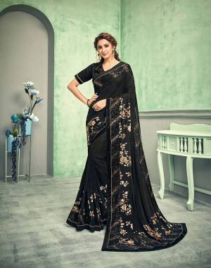 This saree is the personification of glamour, glitz and charm. Look like a showstopper as you sashay down your next cocktail soiree looking like a model straight out of a fashion magazine.
