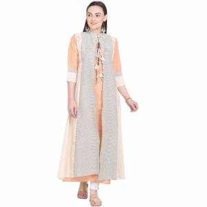 Celebrate This Festive Season With Beauty And Comfort Wearing This Designer Pair Of Kurti. This Pretty Kurti Is In Light Orange Color Paired With Cream Colored Jacket. This Kurti And Jacket Are Fabricated On Cotton Beautified With Prints And Thread Work.
