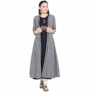 Celebrate This Festive Season With Beauty And Comfort Wearing This Designer Pair Of Kurti. This Pretty Kurti Is In Black Color Paired With Black And White Colored Jacket. This Kurti And Jacket Are Fabricated On Cotton Beautified With Prints And Thread Work.