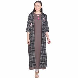 Simple and Elegant Looking Readymade Pair Of Kurti Is Here Which IS Cotton Based. This Kurti Is In Brown Color Paired With Black And Grey Colored Jacket. Buy This Unique Piece Now.