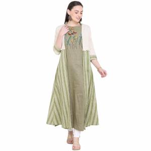 Celebrate This Festive Season With Beauty And Comfort Wearing This Designer Pair Of Kurti. This Pretty Kurti Is In Olive Green Color Paired With Cream And Olive Green Colored Jacket. This Kurti And Jacket Are Fabricated On Cotton Beautified With Prints And Thread Work.