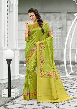 For A Proper Traditional Look, Grab This Designer Silk Based Saree In Parrot Green Color. This Saree Is Fabricated On Banarasi Silk Paired With Art Silk Fabricated Blouse, Beautified With Attractive Floral Weave.
