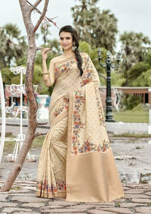 Add This Beautiful And Elegant Looking Saree To Your Wardrobe In Cream Color. This Pretty Floral Weaved Saree Is Fabricated On Banarasi Silk Paired With Art Silk Fabricated Blouse.