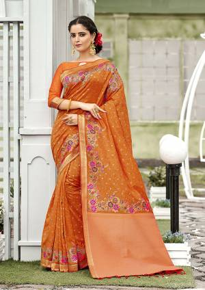 For A Proper Traditional Look, Grab This Designer Silk Based Saree In Orange Color. This Saree Is Fabricated On Banarasi Silk Paired With Art Silk Fabricated Blouse, Beautified With Attractive Floral Weave.