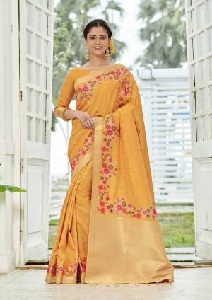 Add This Beautiful And Elegant Looking Saree To Your Wardrobe In Musturd Yellow Color. This Pretty Floral Weaved Saree Is Fabricated On Banarasi Silk Paired With Art Silk Fabricated Blouse.