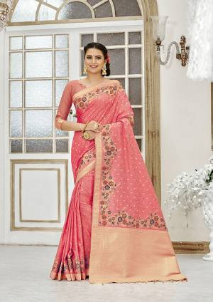 Add This Beautiful And Elegant Looking Saree To Your Wardrobe In Peach Color. This Pretty Floral Weaved Saree Is Fabricated On Banarasi Silk Paired With Art Silk Fabricated Blouse.