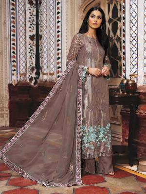 Grab This Heavy Designer Straight Suit In Brown Color. Its Top And Dupatta Are Fabricated On Georgette Paired With Santoon Bottom. It Is Beautified With Heavy Attractive Embroidery Over The Top. Buy Now.