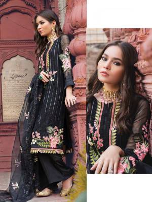 Grab This Heavy Designer Straight Suit In Black Color. Its Top And Dupatta Are Fabricated On Georgette Paired With Santoon Bottom. It Is Beautified With Heavy Attractive Embroidery Over The Top. Buy Now.