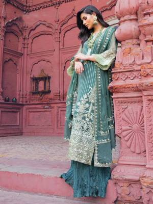 Grab This Heavy Designer Straight Suit In Teal Green Color. Its Top And Dupatta Are Fabricated On Georgette Paired With Santoon Bottom. It Is Beautified With Heavy Attractive Embroidery Over The Top. Buy Now.
