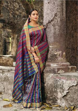 Grab This Pretty Silk Based Saree In Multi Color Paired With Sea Green Colored Blouse. This Saree Is Fabricated On Cotton Silk Paired With Art Silk Fabricated Blouse.