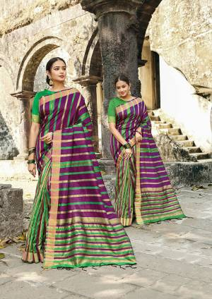 Rich And Elegant Looking Designer Saree Is Here To Add Into Your Wardrobe In Purple Color Paired With Green Colored Blouse. This Saree Is Fabricated On Cotton Silk Paired With Art Silk Fabricated Blouse. It Is Light Weight, Durable And Easy To Carry All Day Long.