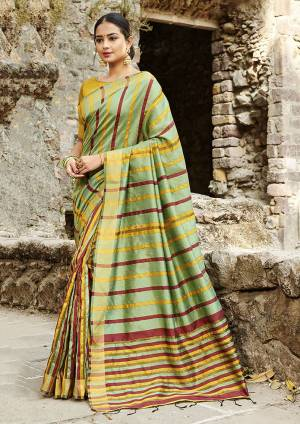 Rich And Elegant Looking Designer Saree Is Here To Add Into Your Wardrobe In Light Green Color Paired With Yellow Colored Blouse. This Saree Is Fabricated On Cotton Silk Paired With Art Silk Fabricated Blouse. It Is Light Weight, Durable And Easy To Carry All Day Long.