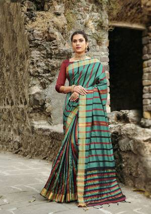 Rich And Elegant Looking Designer Saree Is Here To Add Into Your Wardrobe In Teal Blue Color Paired With Maroon Colored Blouse. This Saree Is Fabricated On Cotton Silk Paired With Art Silk Fabricated Blouse. It Is Light Weight, Durable And Easy To Carry All Day Long.