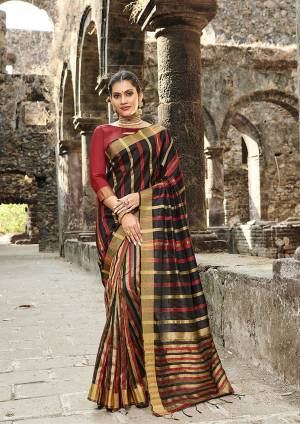 Grab This Pretty Silk Based Saree In Black Color Paired With Red Colored Blouse. This Saree Is Fabricated On Cotton Silk Paired With Art Silk Fabricated Blouse.