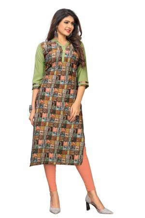 Add Some Casuals To Your Wardrobe With This Simple Kurti Fabricated On Crepe. This Pretty Kurti IS Beautified With Prints And Can be Paired With Same Of Contrasting Colored Bottom.