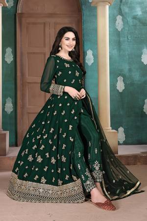Here Is A Very Pretty Heavy Designer Indo-Western Suit In Dark Green Color. Its Emnbroidred Floor Length To Is Fabricated On Georgette Paired With Embroidered Bottom Fabricated On Santoon and Net Fabricated Dupatta.