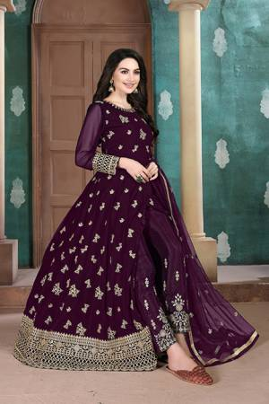 Here Is A Very Pretty Heavy Designer Indo-Western Suit In Dark Wine Color. Its Emnbroidred Floor Length To Is Fabricated On Georgette Paired With Embroidered Bottom Fabricated On Santoon and Net Fabricated Dupatta.