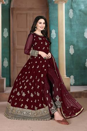 Here Is A Very Pretty Heavy Designer Indo-Western Suit In Maroon Color. Its Emnbroidred Floor Length To Is Fabricated On Georgette Paired With Embroidered Bottom Fabricated On Santoon and Net Fabricated Dupatta.
