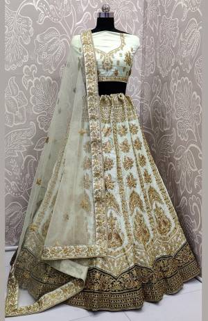 Here Is A Very Beautiful And Attractive Looking Heavy Designer Lehenga Choli In Pastel Green Color. Its Blouse Is Fabricated On Satin Silk Paired With Satin Silk And Velvet Fabricated Lehenga And Net Fabricated Dupatta. Buy Now.