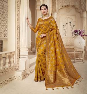 Shine Bright Wearing This Rich Silk Based Designer Saree In Musturd Yellow Color. This Saree Is Fabricated On Banarasi Silk Paired With Art Silk Fabricated Blouse. It Is Beautified With Heavy Detailed Weaved Giving An Attractive Look .