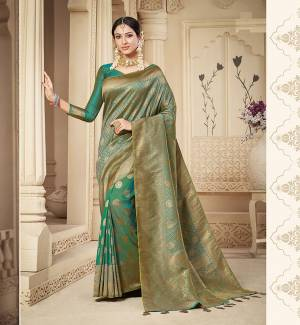 For A Proper Traditional Look, Grab This Pretty Designer Saree In Green Color. This Saree Is Banarasi Silk Based Beautified With Detailed Attractive Weave Paired With Art Silk Fabricated Blouse. Buy Now.