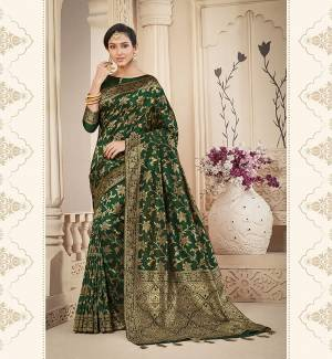 For A Proper Traditional Look, Grab This Pretty Designer Saree In Dark Green Color. This Saree Is Banarasi Silk Based Beautified With Detailed Attractive Weave Paired With Art Silk Fabricated Blouse. Buy Now.