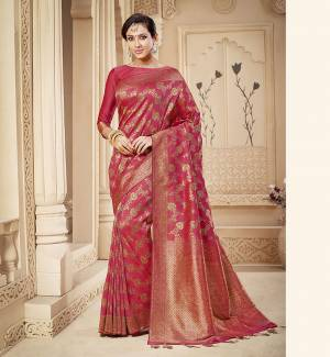 Shine Bright Wearing This Rich Silk Based Designer Saree In Dark Pink Color. This Saree Is Fabricated On Banarasi Silk Paired With Art Silk Fabricated Blouse. It Is Beautified With Heavy Detailed Weaved Giving An Attractive Look .