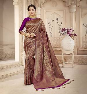 For A Proper Traditional Look, Grab This Pretty Designer Saree In Purple Color. This Saree Is Banarasi Silk Based Beautified With Detailed Attractive Weave Paired With Art Silk Fabricated Blouse. Buy Now.