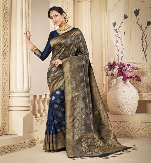 Shine Bright Wearing This Rich Silk Based Designer Saree In Navy Blue Color. This Saree Is Fabricated On Banarasi Silk Paired With Art Silk Fabricated Blouse. It Is Beautified With Heavy Detailed Weaved Giving An Attractive Look .