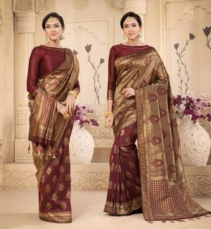 For A Proper Traditional Look, Grab This Pretty Designer Saree In Maroon Color. This Saree Is Banarasi Silk Based Beautified With Detailed Attractive Weave Paired With Art Silk Fabricated Blouse. Buy Now.