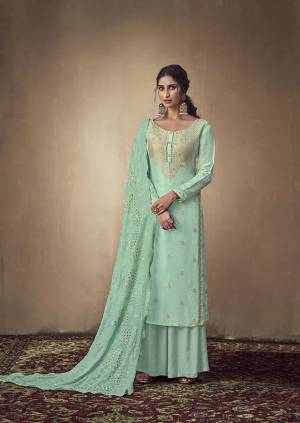 Here Is A Rich And Elegant Looking Designer Straight Suit In Sea Green Color. Its Elegant Top Is Fabricated On Banarasi Jacquard Paired With Satin Bottom And Georgette Fabricated Lakhnavi Embroidered Dupatta. Its Subtle Tone To Tone Embroidery Gives Rich And Elegant Look To Your Personality.