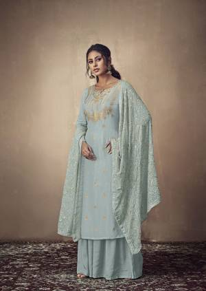 Here Is A Rich And Elegant Looking Designer Straight Suit In Dusty Blue Color. Its Elegant Top Is Fabricated On Banarasi Jacquard Paired With Satin Bottom And Georgette Fabricated Lakhnavi Embroidered Dupatta. Its Subtle Tone To Tone Embroidery Gives Rich And Elegant Look To Your Personality.