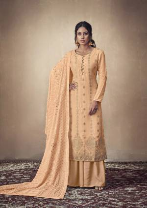 You Will Definitely Earn Lots Of Compliments Wearing This Designer Straight Suit In Light Orange Color. Its Weaved Top Is Fabricated Banarasi Jacquard Paired With Satin Fabricated Bottom And Georgette Fabricated Dupatta Which Is Beautified With Pretty Tone To Tone Lakhnavi Work.