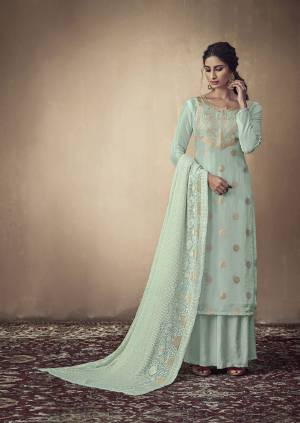 Here Is A Rich And Elegant Looking Designer Straight Suit In Sky Blue Color. Its Elegant Top Is Fabricated On Banarasi Jacquard Paired With Satin Bottom And Georgette Fabricated Lakhnavi Embroidered Dupatta. Its Subtle Tone To Tone Embroidery Gives Rich And Elegant Look To Your Personality.
