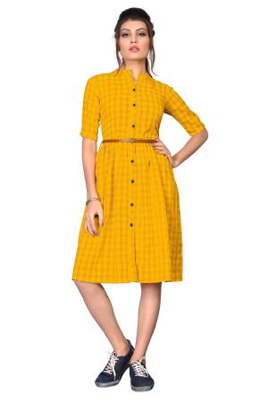 Here Is A Pretty Tunic Patterned Kurti In Yellow Color. This Readymade Kurti Is Fabricated On Cotton Beautified With Checks Prints. Its Fabric Is Light Weight And Easy To Carry All Day Long.