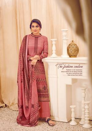 Look Pretty Wearing This Lovely Suit For The Upcoming Winters In Pink Color. Its Top, Bottom And Dupatta Are Fabricated On Wool Pashmina Beautified With Prints And Stone Work. Buy This Suit Now.