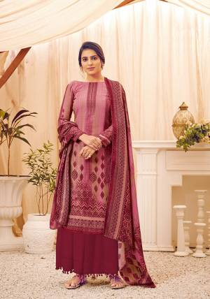 Look Pretty Wearing This Lovely Suit For The Upcoming Winters In Magenta Pink Color. Its Top, Bottom And Dupatta Are Fabricated On Wool Pashmina Beautified With Prints And Stone Work. Buy This Suit Now.