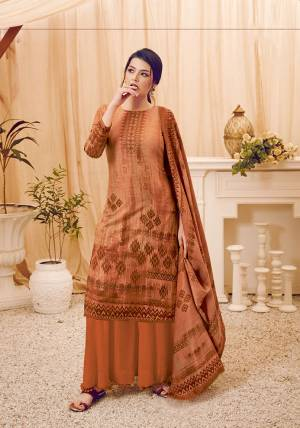 Add This Beautiful Designer Straight Suit In Light Brown Color. Its Pretty Top, Bottom And Dupatta Are Fabricated On Wool Pashmina Beautified With Prints And Stone Work. Its Fabric Is Soft Towards Skin And Suitable For The Upcoming Winters.