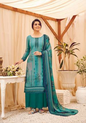 Look Pretty Wearing This Lovely Suit For The Upcoming Winters In Blue Color. Its Top, Bottom And Dupatta Are Fabricated On Wool Pashmina Beautified With Prints And Stone Work. Buy This Suit Now.