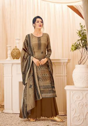 Add This Beautiful Designer Straight Suit In Brown Color. Its Pretty Top, Bottom And Dupatta Are Fabricated On Wool Pashmina Beautified With Prints And Stone Work. Its Fabric Is Soft Towards Skin And Suitable For The Upcoming Winters.
