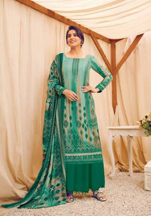 Look Pretty Wearing This Lovely Suit For The Upcoming Winters In Sea Green Color. Its Top, Bottom And Dupatta Are Fabricated On Wool Pashmina Beautified With Prints And Stone Work. Buy This Suit Now.