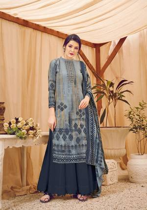 Add This Beautiful Designer Straight Suit In Dark Grey Color. Its Pretty Top, Bottom And Dupatta Are Fabricated On Wool Pashmina Beautified With Prints And Stone Work. Its Fabric Is Soft Towards Skin And Suitable For The Upcoming Winters.