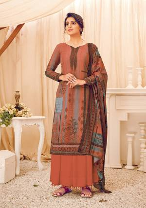 Look Pretty Wearing This Lovely Suit For The Upcoming Winters In Rust Color. Its Top, Bottom And Dupatta Are Fabricated On Wool Pashmina Beautified With Prints And Stone Work. Buy This Suit Now.